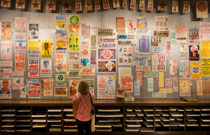 The Hatch poster shop displays concert posters in Nashville, Tennessee. Hatch has created concert posters for ...