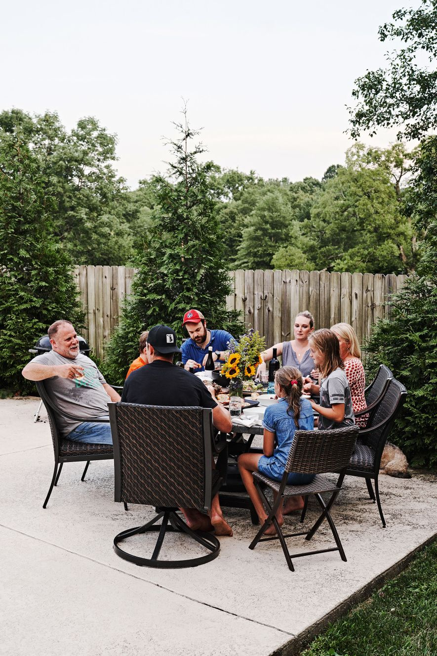The Martin family sit down to eat. Getting out the grill to create smoky flavours is ...