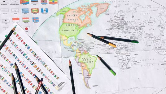 A world map with flags for your kids to colour