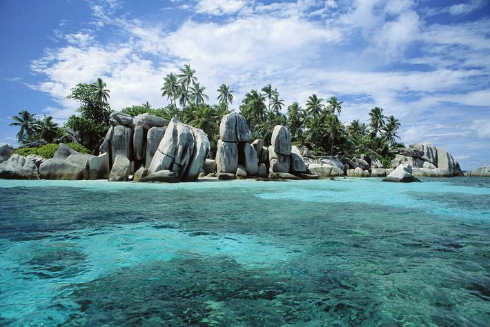 The longest beach in La Digue, Grand Anse's stretch of white sand and turquoise water makes ...