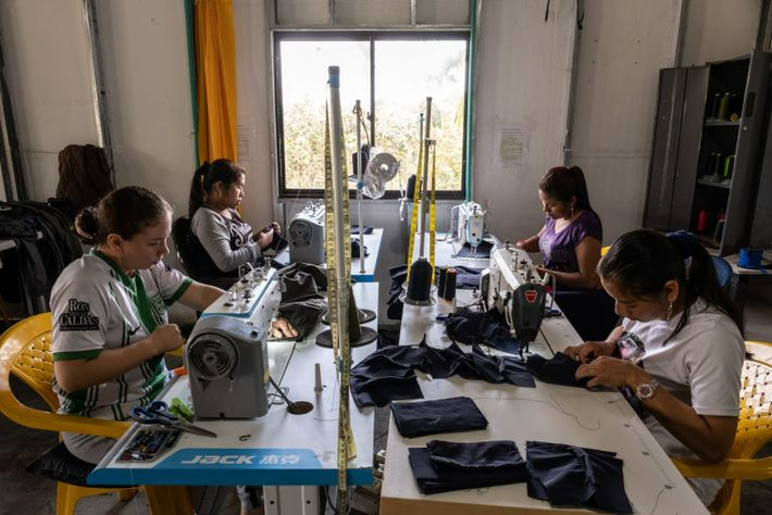 Women at the Anorí camp sew items for a manufacturing cooperative that makes backpacks and clothes ...