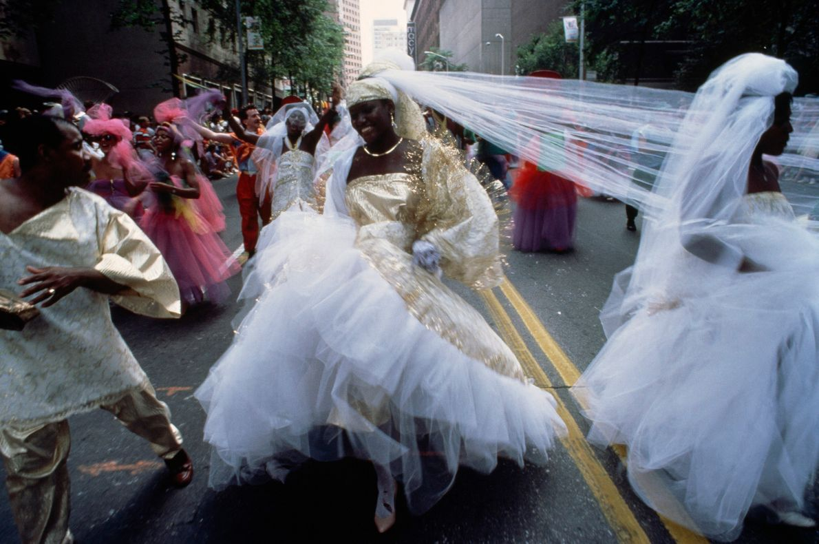 A couple celebrates their wedding at a Fourth of July parade in Atlanta, Georgia. The July ...