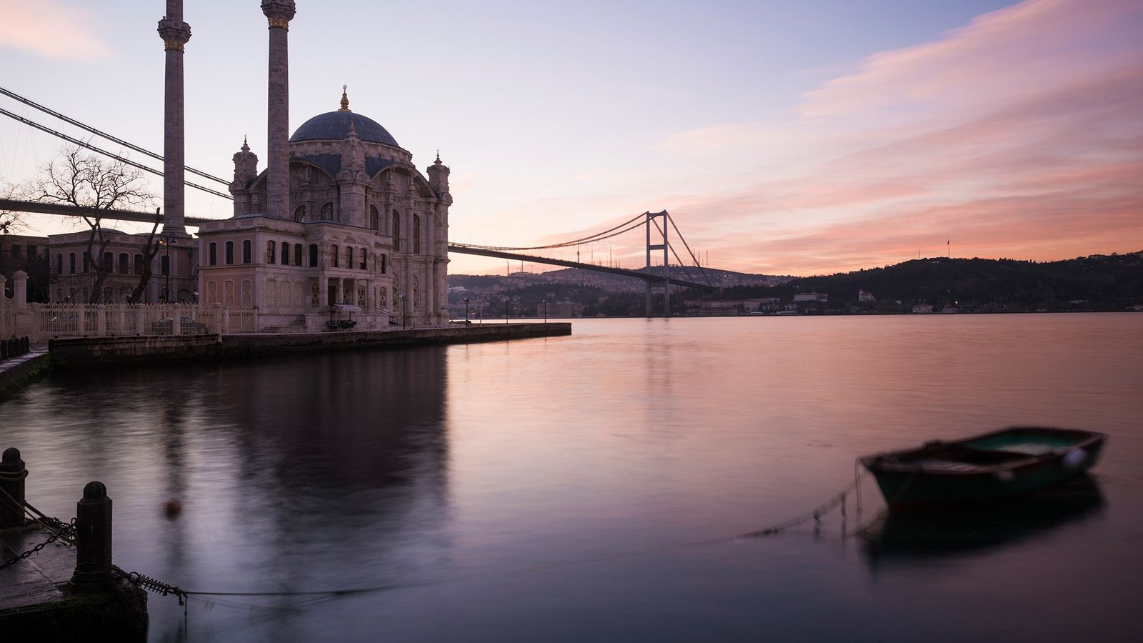 Dawn casts a rosy glow on Ortakoy Mosque in Istanbul, Turkey. Boreholes in the nearby Sea ...