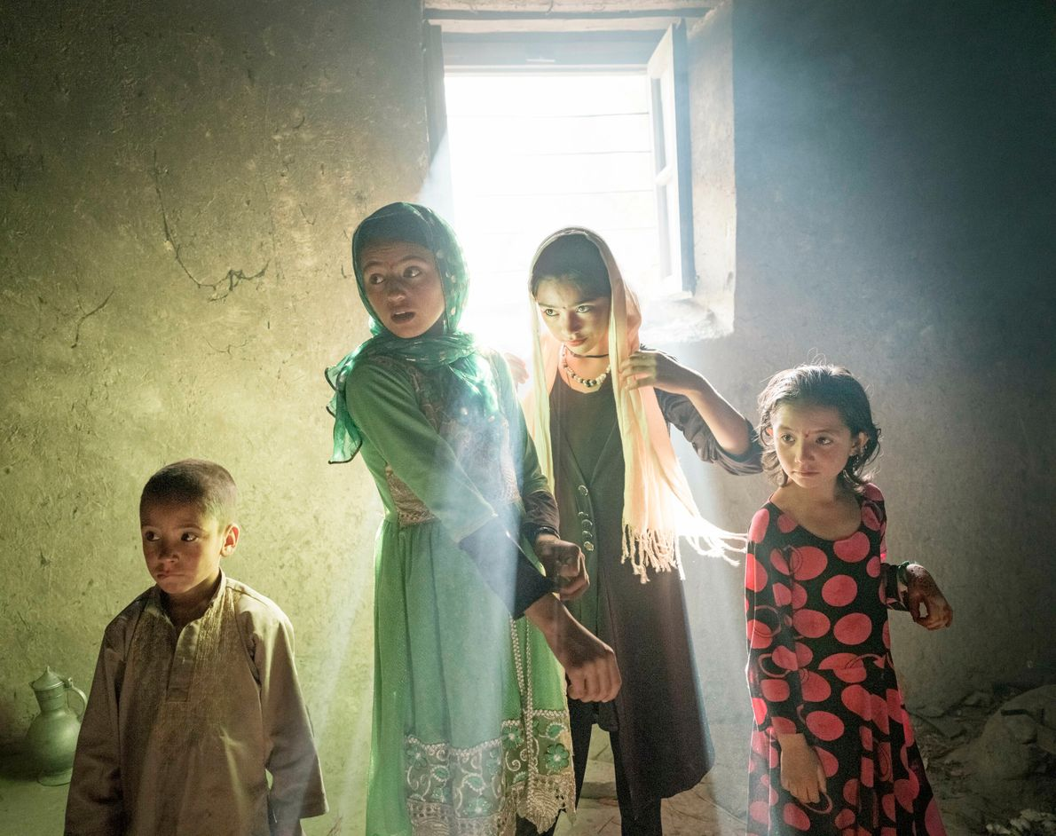 In the village of Qalahye Panjah, Afghanistan, children gather early in the morning on the Muslim ...