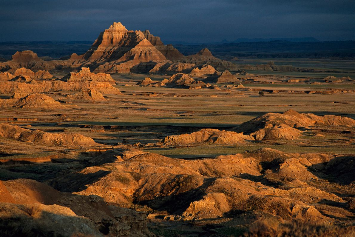 Badlands National Park in South Dakota is made up of jagged and striped rock formations. Before ...