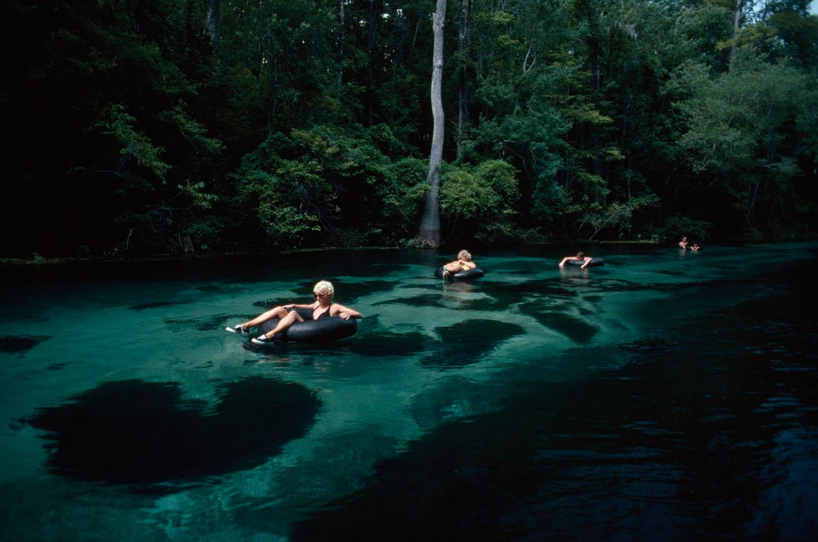 River rafters go tubing down the Ichetucknee River in Florida. This picture appeared in the July ...
