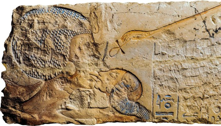 In a relief from Amarna, Queen Nefertiti embraces                    and kisses her eldest daughter, Princess Meritaten, as                    ...