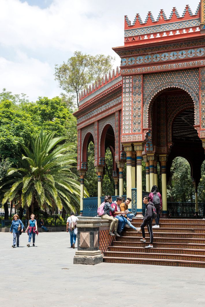 People gather at the Kiosco Morisco, a beautifully intricate structure located in the centre of the ...