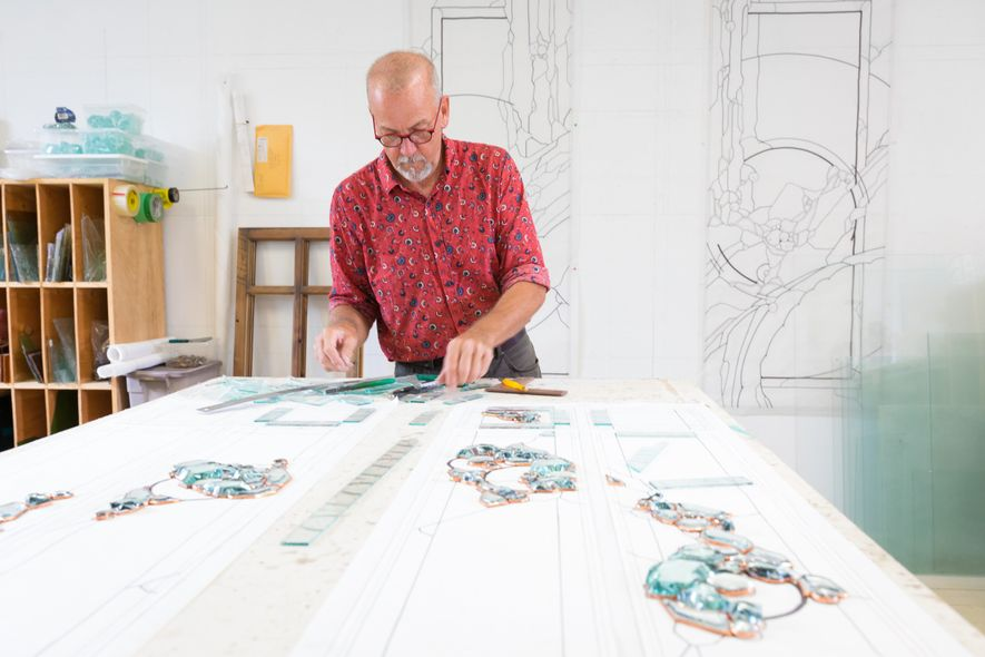 Neil Hanscomb, artist and owner of Hanscomb Glass, in his studio has been crafting custom made ...