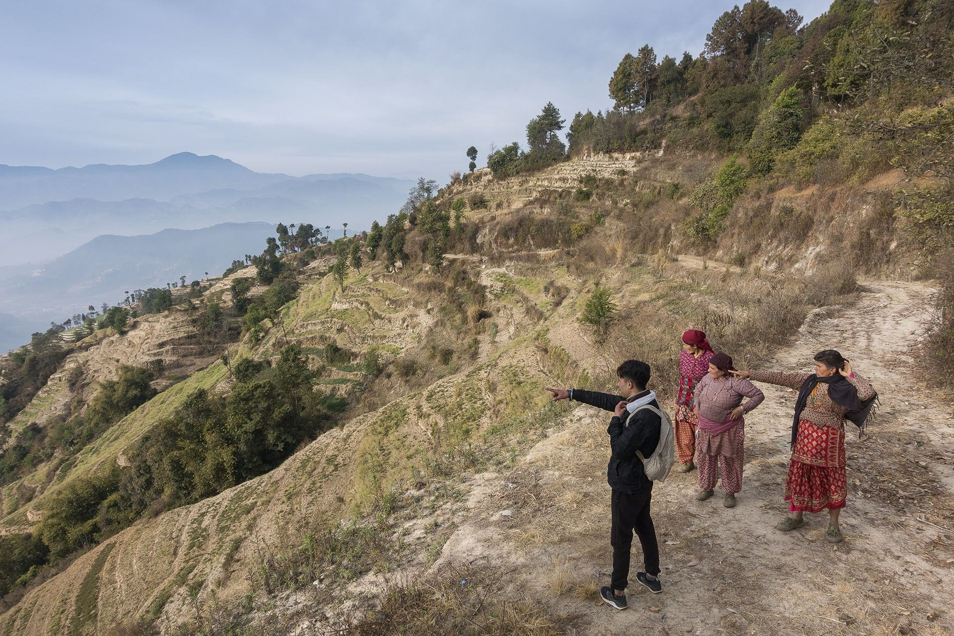 A guide from Nagarkot, being shown a shortcut on a trek from Nagarkot to Dhulikhel.