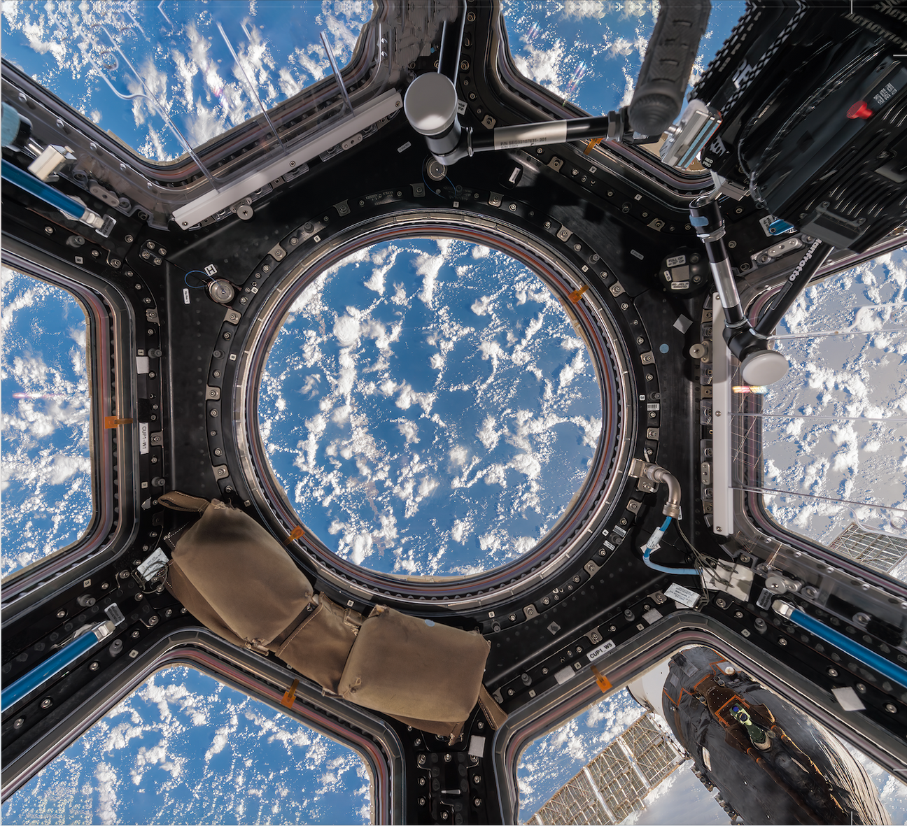 Looking out of the 'Cupola,' an observation window of the ISS built by the European Space ...