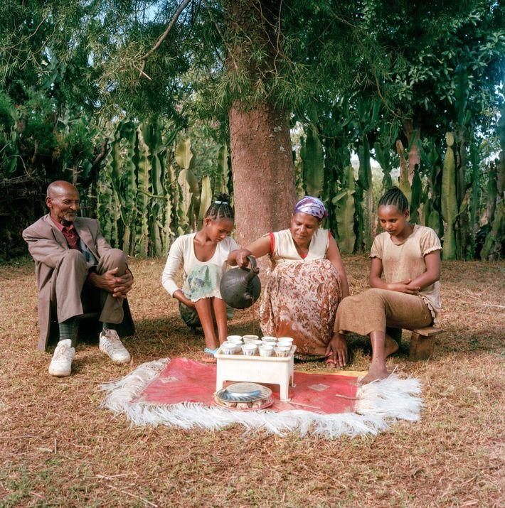 Bekele Erango, Birtukan and their children sit down to enjoy some of their distinctive coffee—an age-old ...