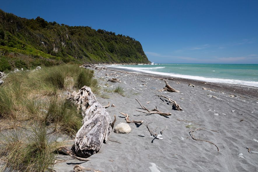 The South Island's Okarito Beach is the perfect place to watch the sun set above the ...
