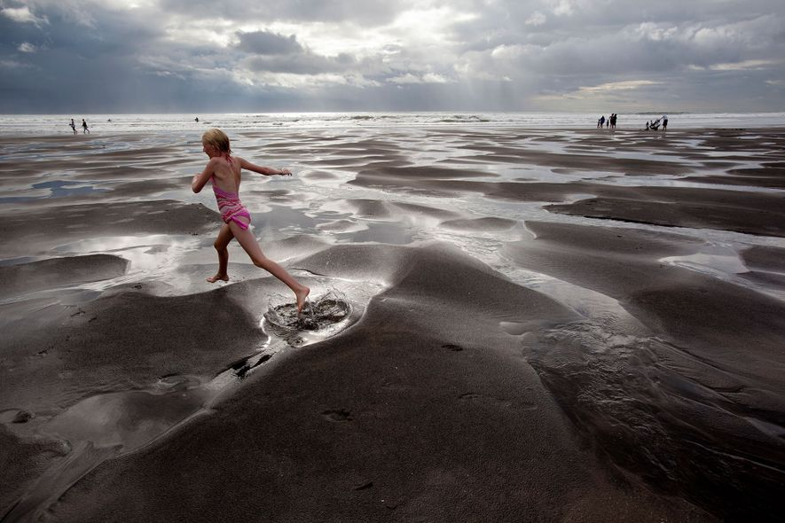 Piha's dramatic landscapes of black-sand beaches, ferocious surf, hurtling waterfalls, dark mountains, and misty forests are ...