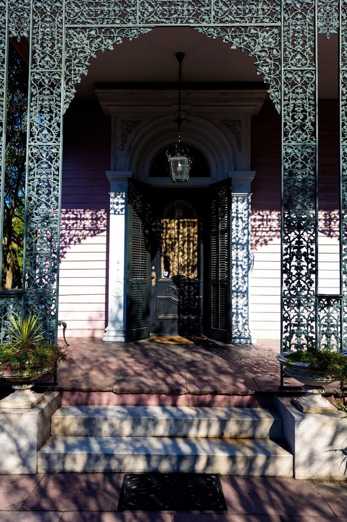 "Balconies and porches exemplify New Orleanians love of ""between spaces,"" where visual connection is possible without ..."