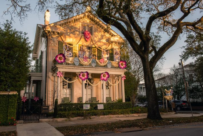 A house on St. Charles Avenue, in New Orleans, participates in the Krewe of House Floats, ...
