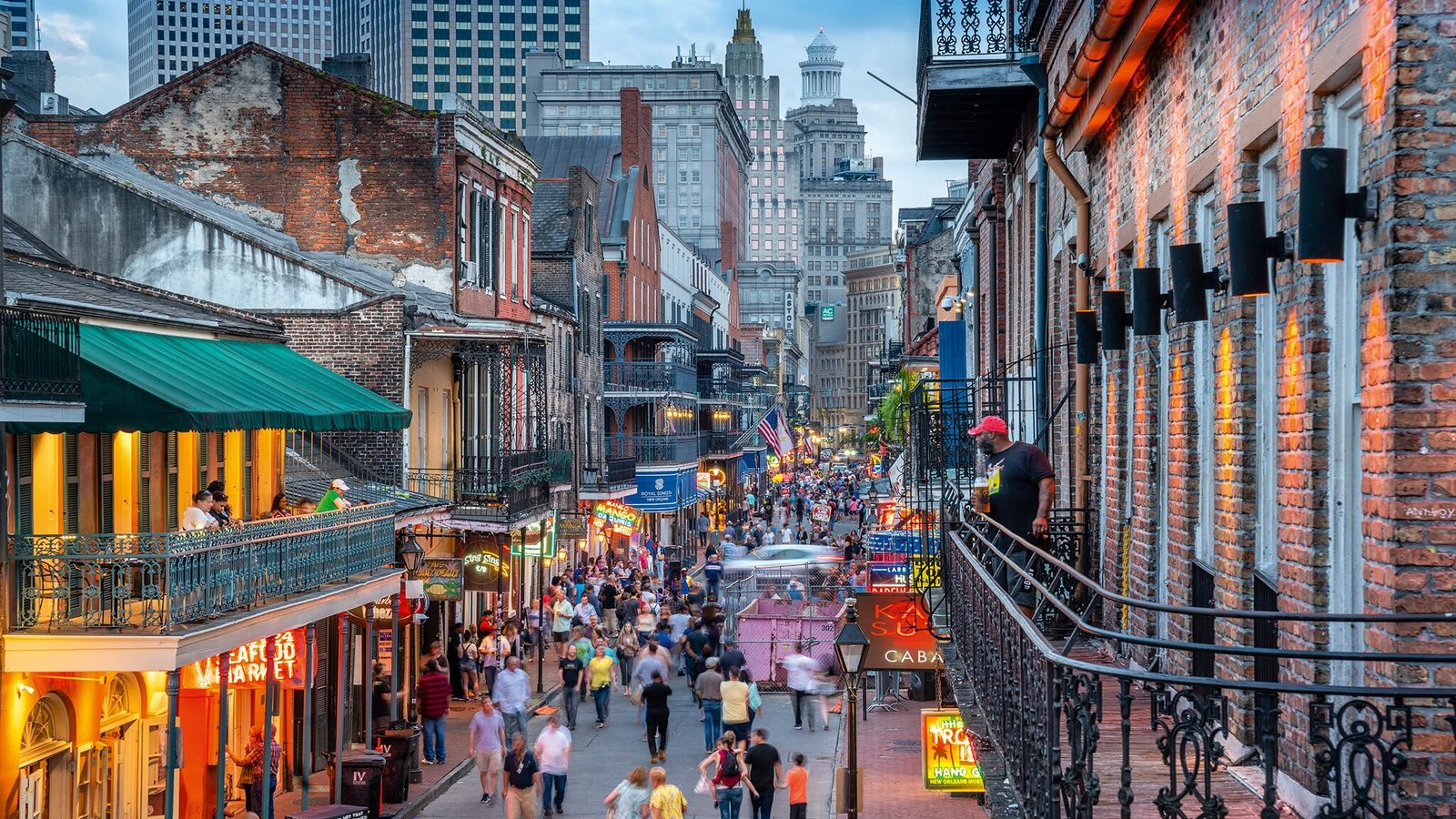 Early evening revelry on Bourbon Street, New Orleans.