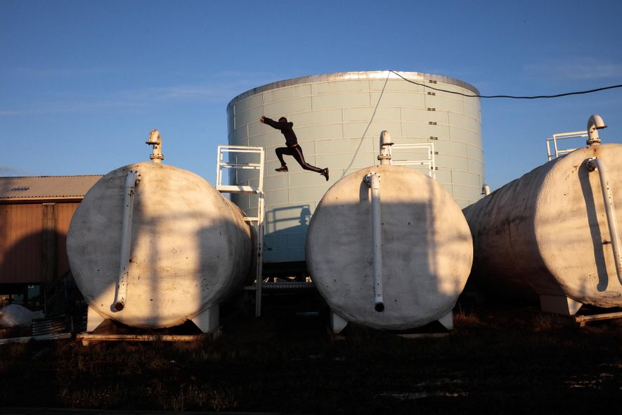 Children play on top of Newtok's aging water treatment facilities.
