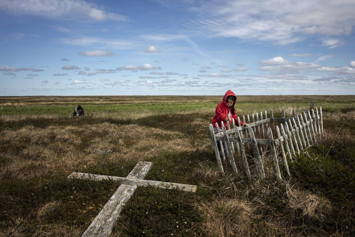 As permafrost thaws, cemeteries in Alaska, like this one in Newtok, are becoming more like marshes, ...