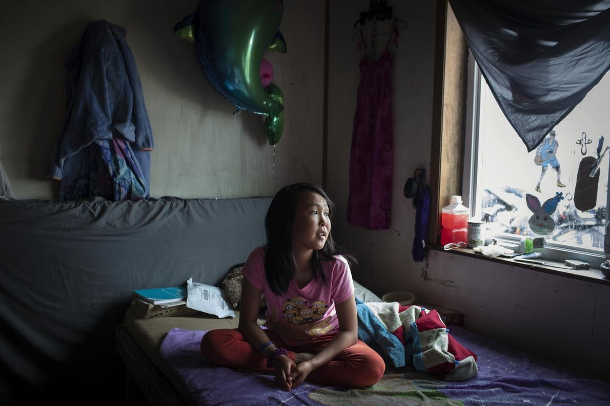 The ceiling of Jasmine Kassaiuli's bedroom recently split as a result of thawing permafrost, which is …
