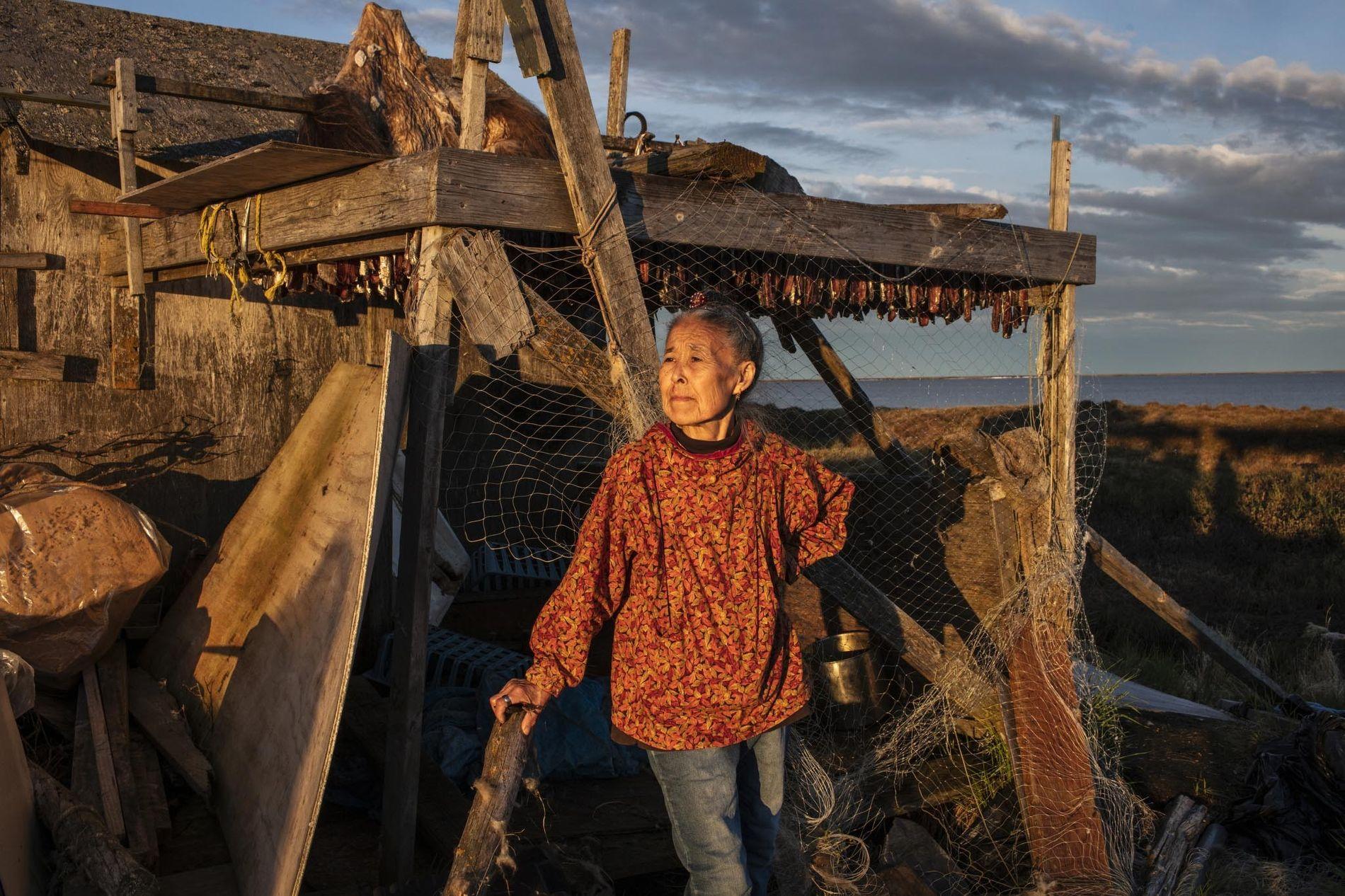 Monica Kasayuli dries herring in Newtok before moving to the new village of Mertarvik.