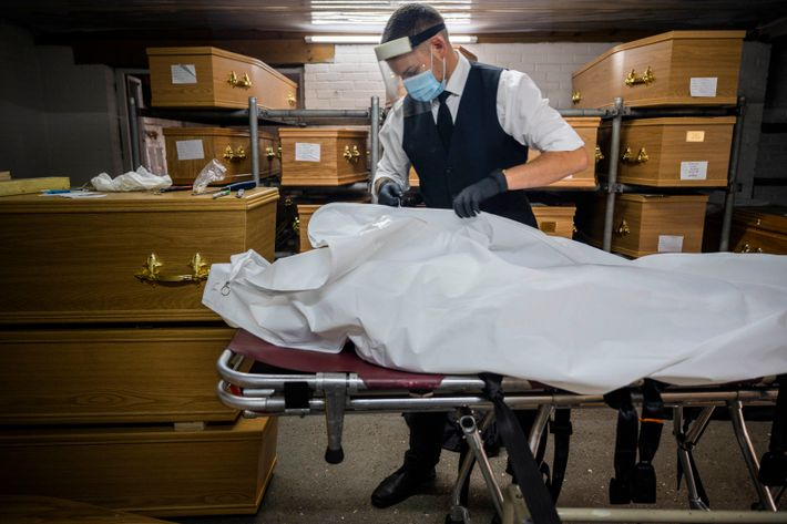 Zak Rolfe, a pallbearer at Stoneman Funeral Services in Surrey prepares to remove a pacemaker from the ...