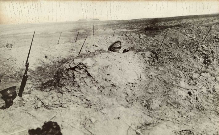 The bayonets of World War I soldiers stick out of the trenches as they carefully watch ...