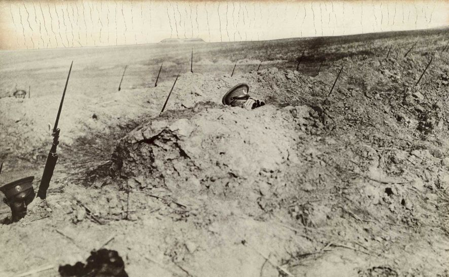 The bayonets of World War I soldiers stick out of the trenches as they carefully watch for the enemy.