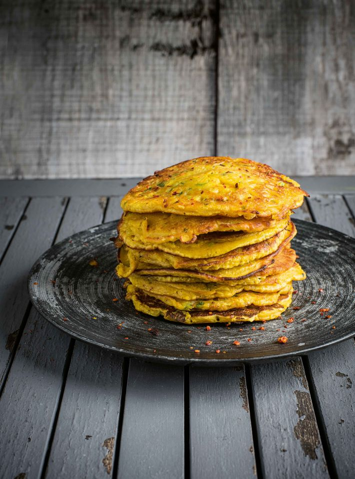 Turmeric pancakes are delicious served with coconut milk yoghurt or chutney.