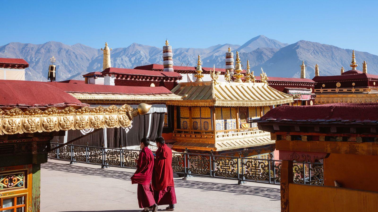 Resident monks stroll through Jokhang Temple, Lhasa, an important destination of Tibetan Buddhist pilgrims.