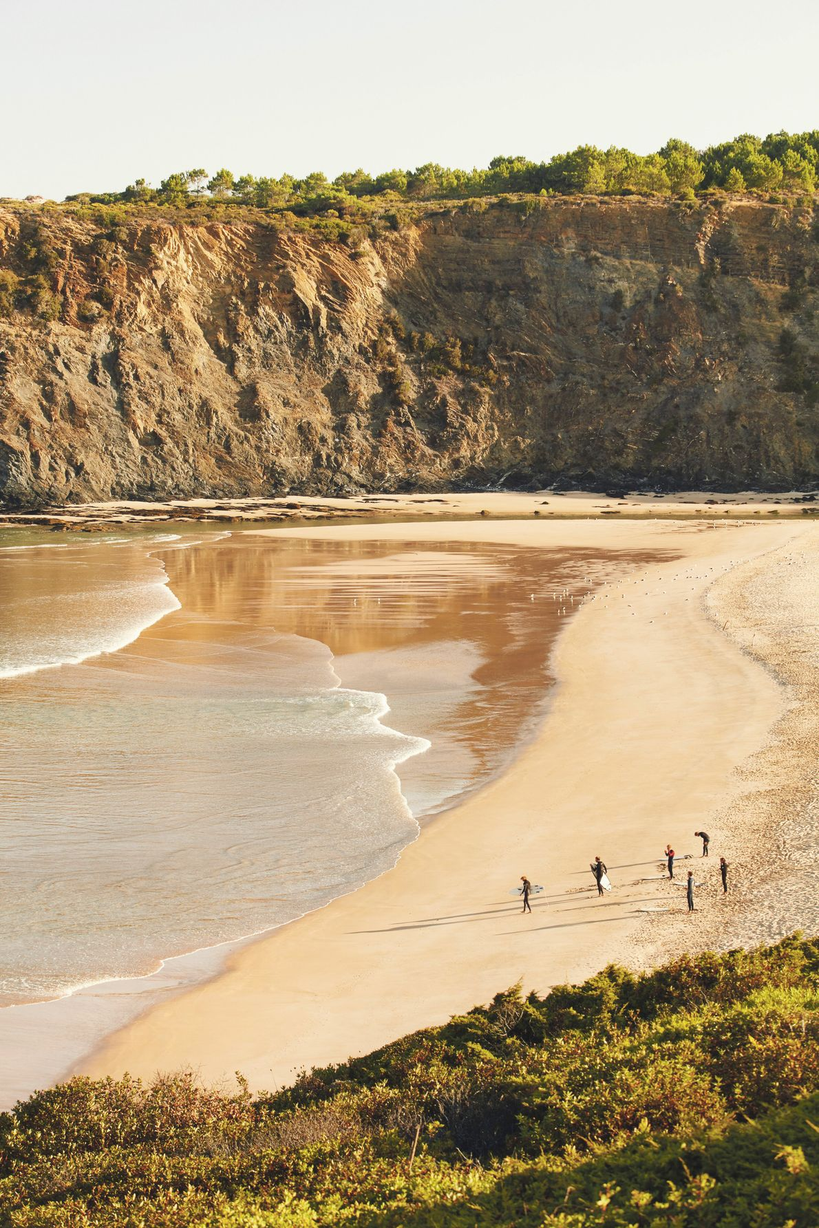 Surfers at Odeceixe Beach, Vicentine Coast Natural Park. There's no shortage of spots to grab a board ...