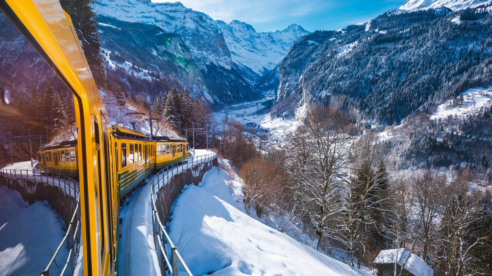 A train ride through the Lauterbrunnen Valley, backed by sheer rock walls and 72 frozen waterfalls.