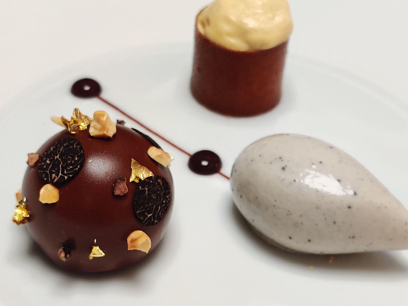 Two-Michelin-star The Greenhouse serves black winter truffle ice cream combined with a chocolate crémeux that's studded ...