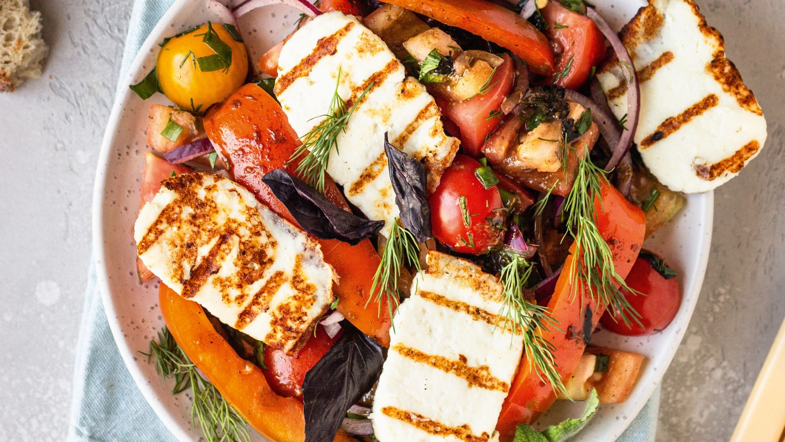 Tomato, red pepper and onion salad with grilled halloumi.