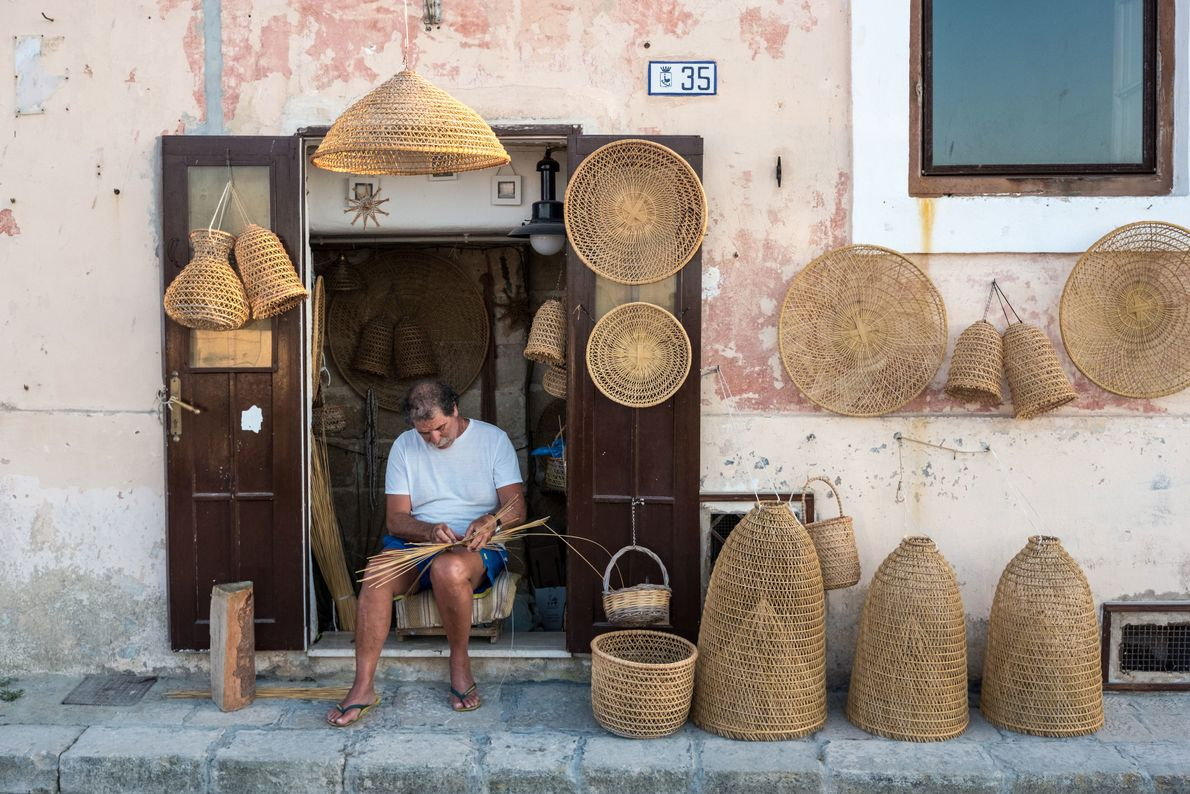 A craftsmen fashions traditional fishing tools in the old town of Gallipoli, on the peninsula's west ...