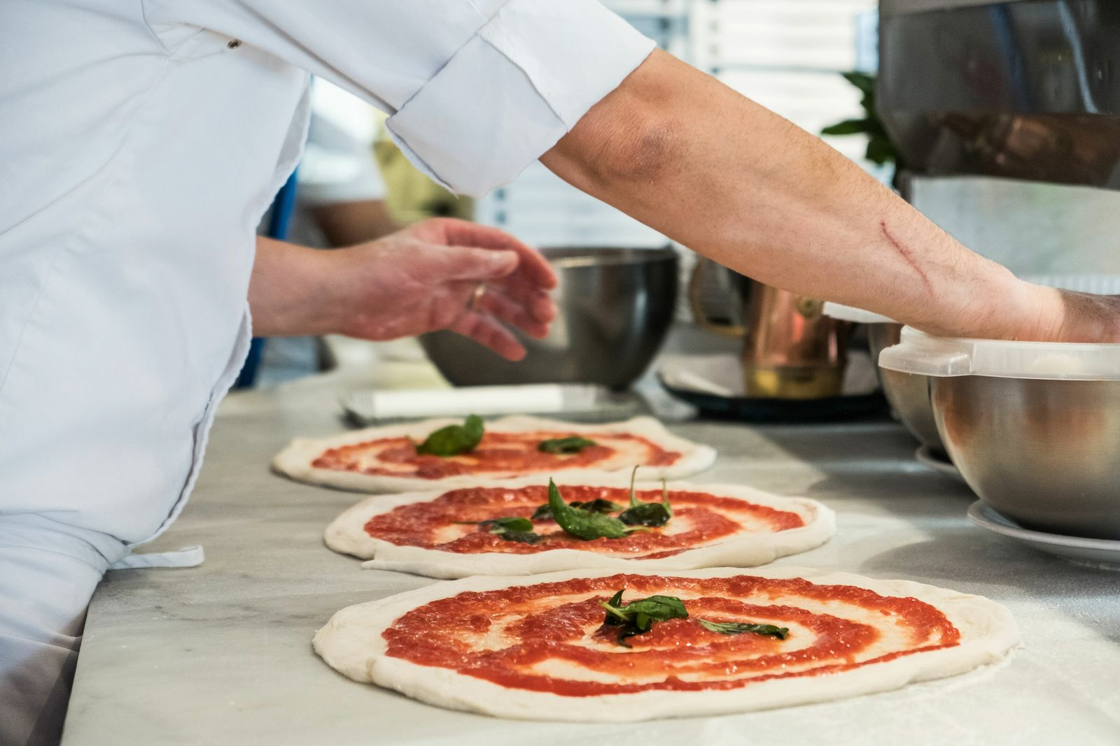 Learn to cook like an Italian in these four culinary hotspots