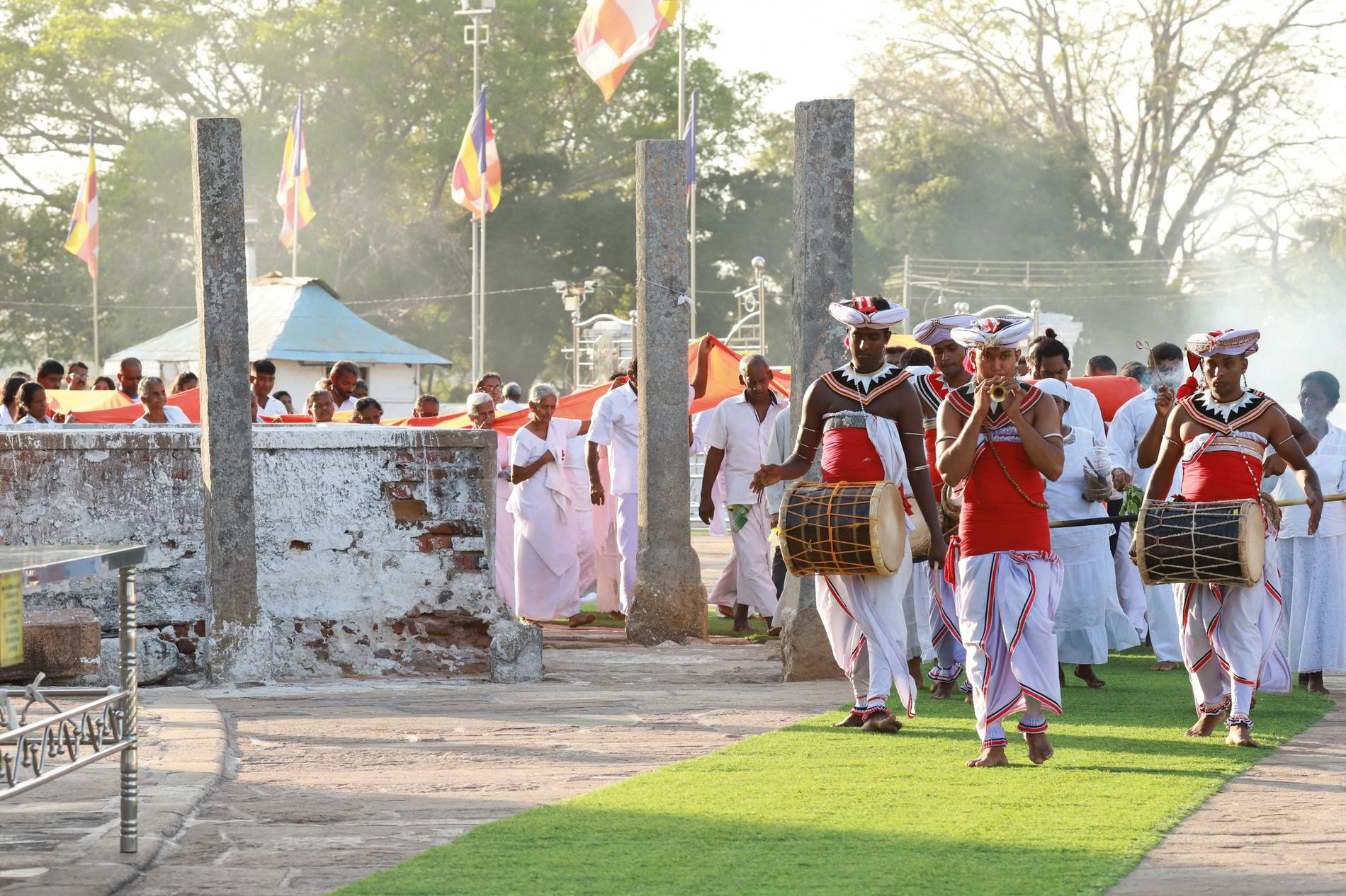 Villagers leading a procession