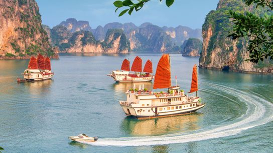 The limestone karsts of Ha Long Bay are said to be jewels spat out by dragons ...