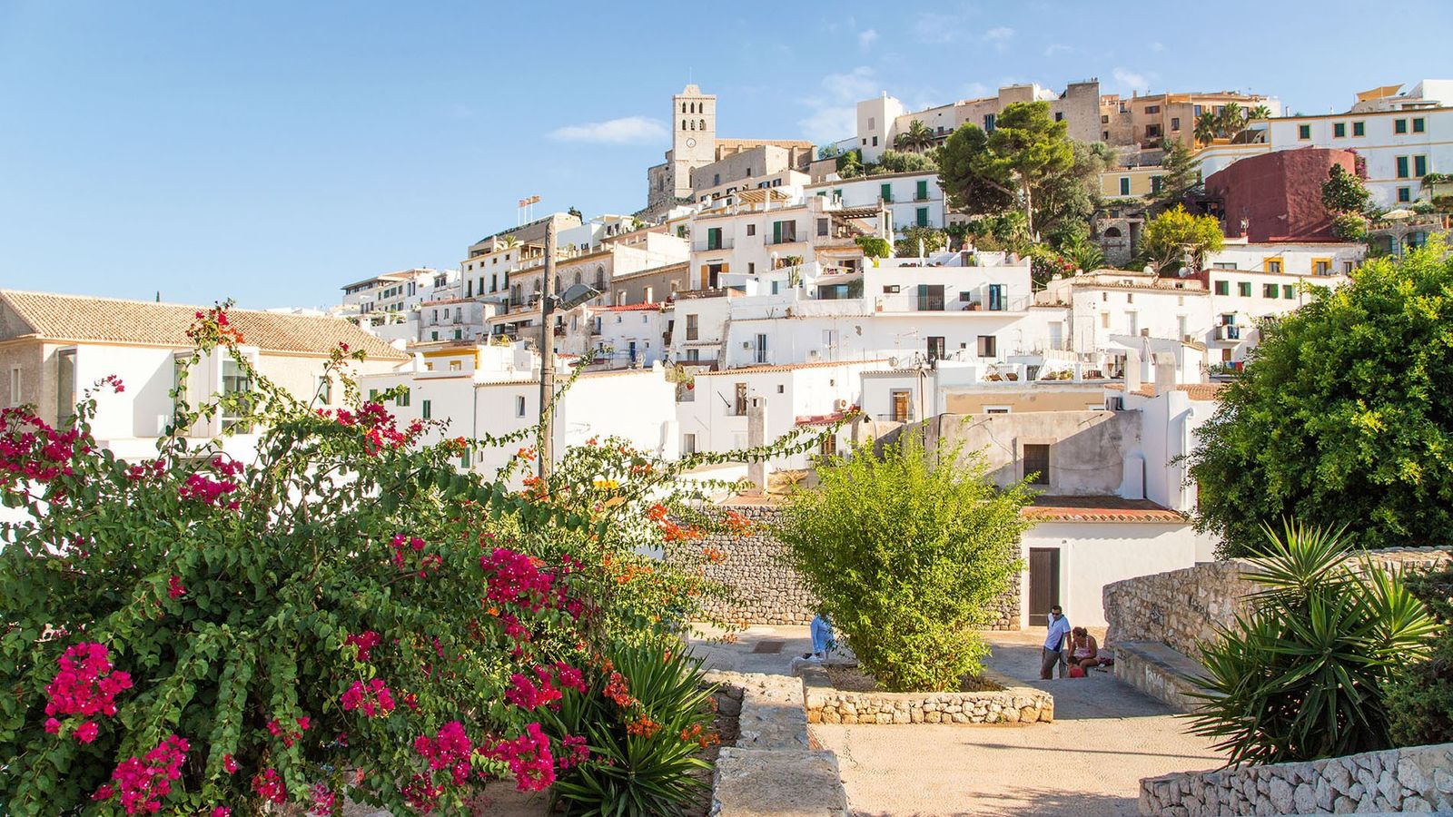 Ibiza's old town, known as Dalt Vila, is a maze of white-painted houses flushed pink with ...