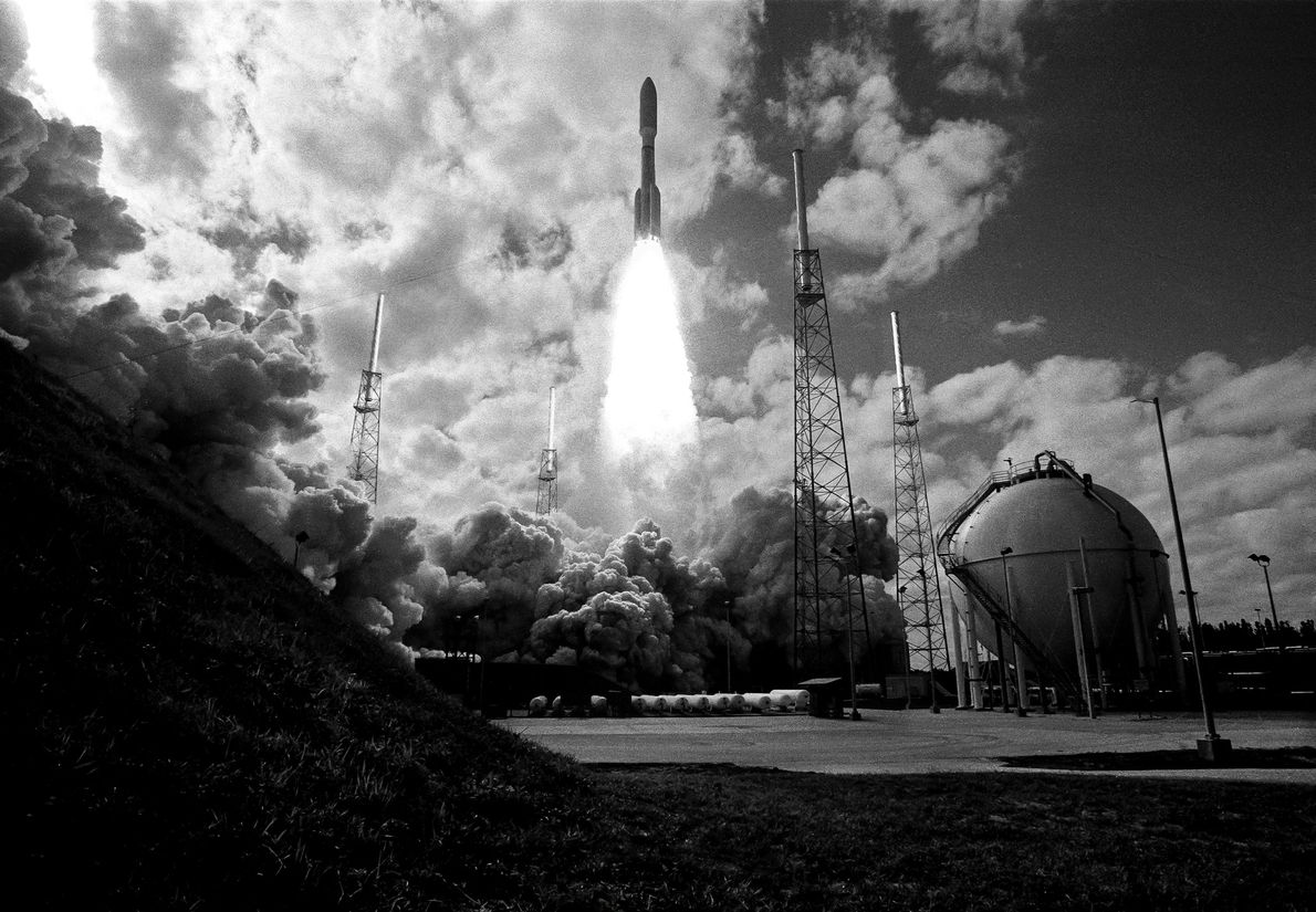 On January 19, 2006, an Atlas V rocket launched New Horizons toward Pluto, as captured here ...