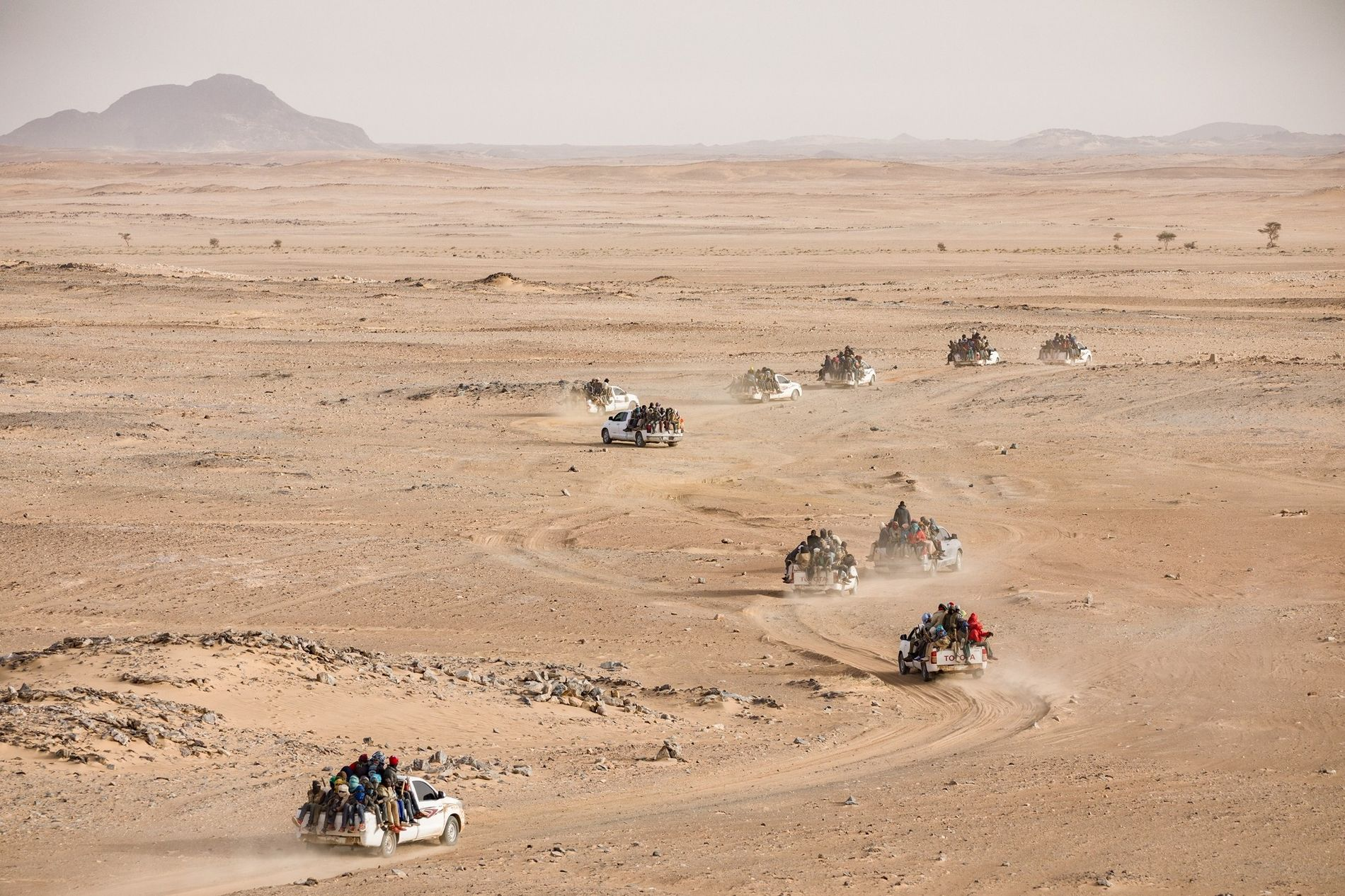 A convoy of pickups packed with Nigeriens and other Africans begins a three-day trek from Agadez, ...