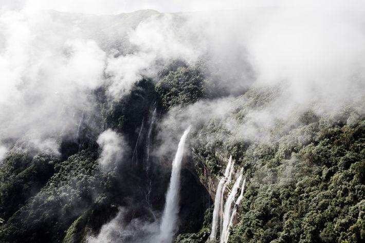 Water cascades down Meghalaya's steep cliffs. It is one of the wettest regions on Earth.