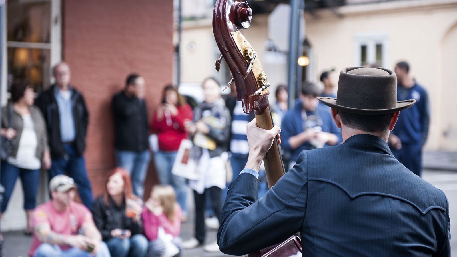 A young man plays double bass on Royal Street, New Orleans