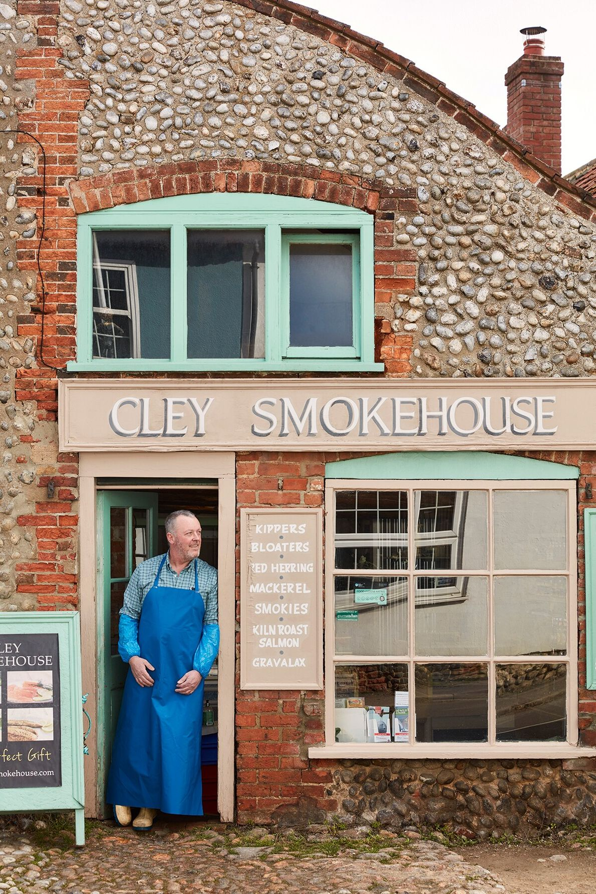 A village with narrow streets lined with flint-walled cottages, Cley next the Sea was one of ...