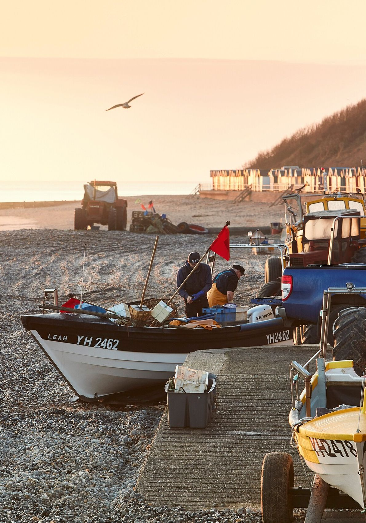 Fishermen load up the boats at dawn at Cromer, ready for a day on the water. ...
