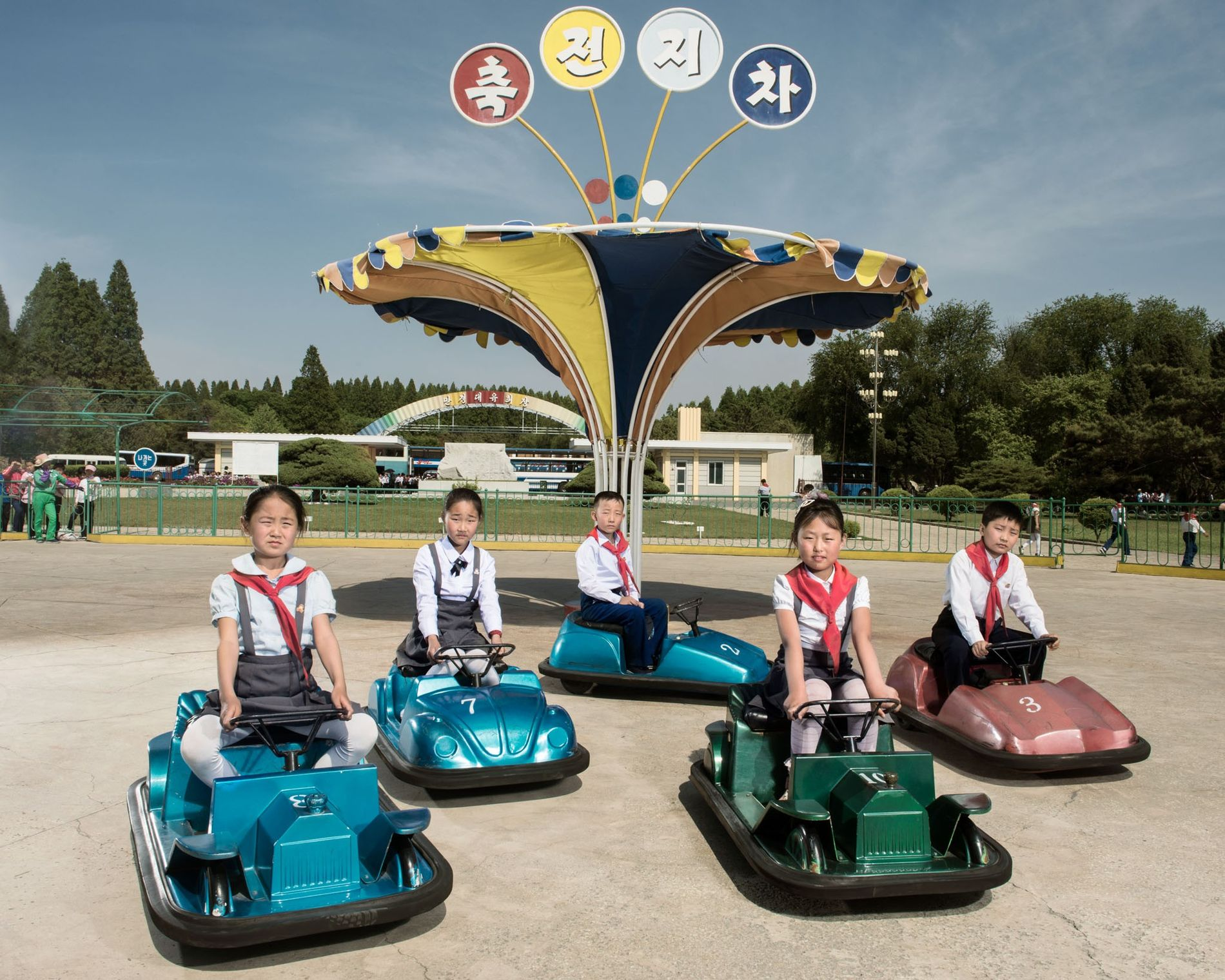 Children pause between collisions on a bumper car course at Mangyongdae Funfair outside Pyongyang. In this ...