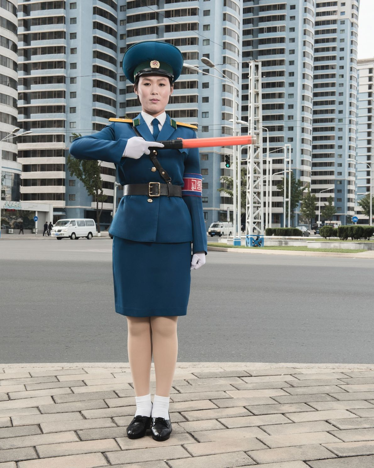 Female traffic officers like O Yong Ae are a common sight on the streets of Pyongyang. ...