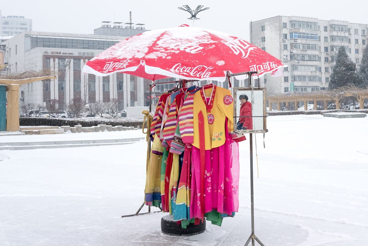 Traditional Korean dresses contrast with the snow near the border in Dandong.