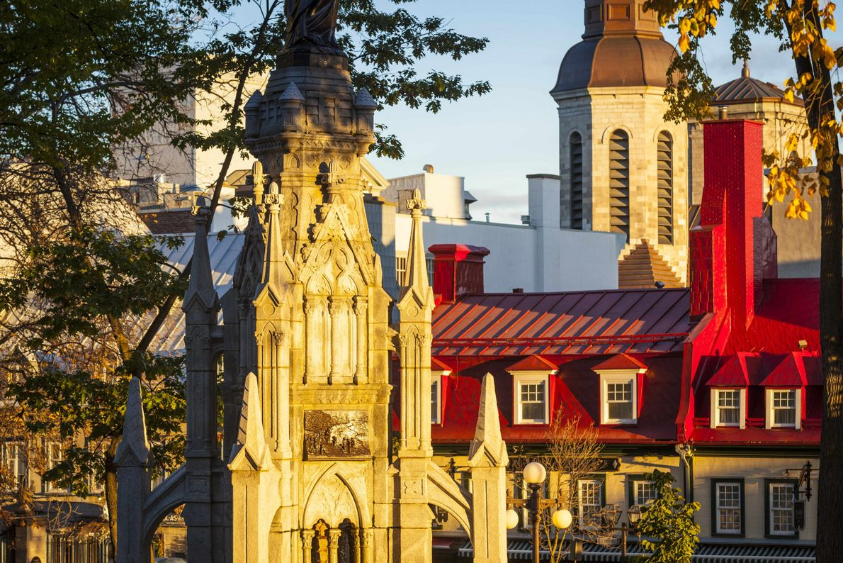 The morning light catches the top of Notre-Dame de Québec Basilica-Cathedral and some of Québec City's ...