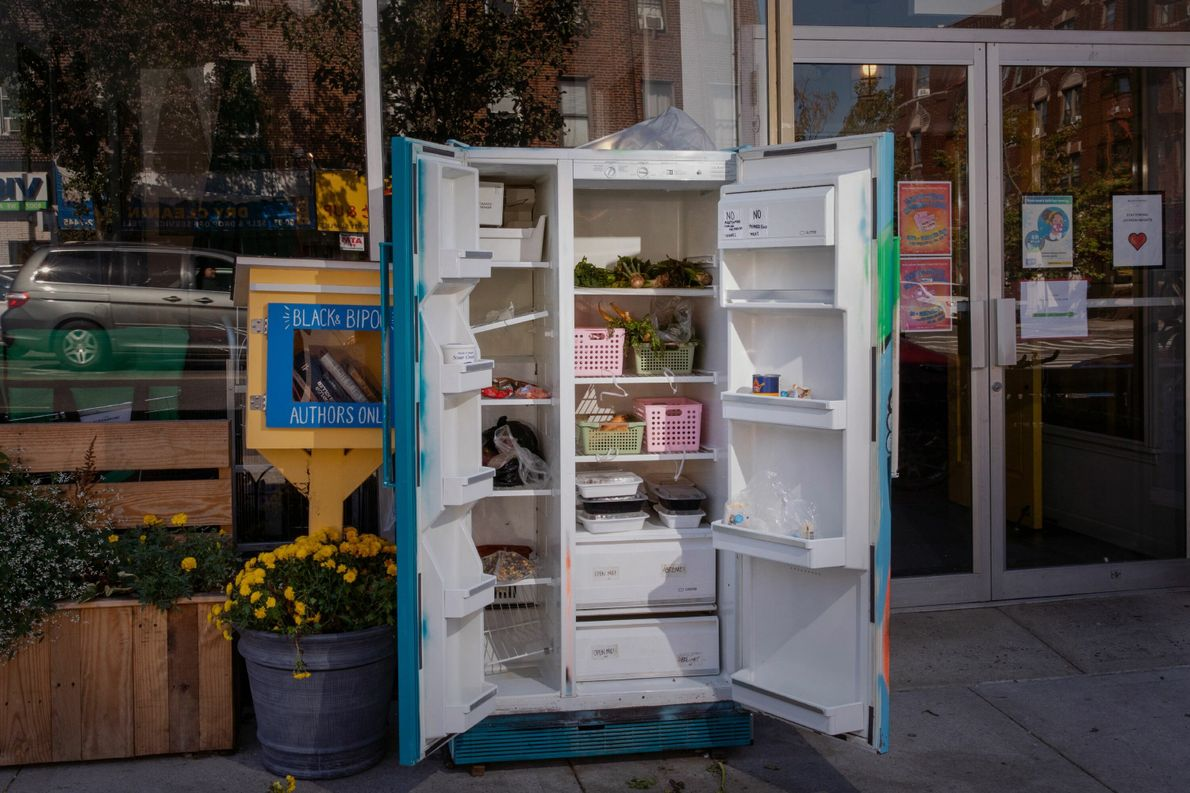 In Queens, New York, a community refrigerator allows people to donate or pick up food. An ...